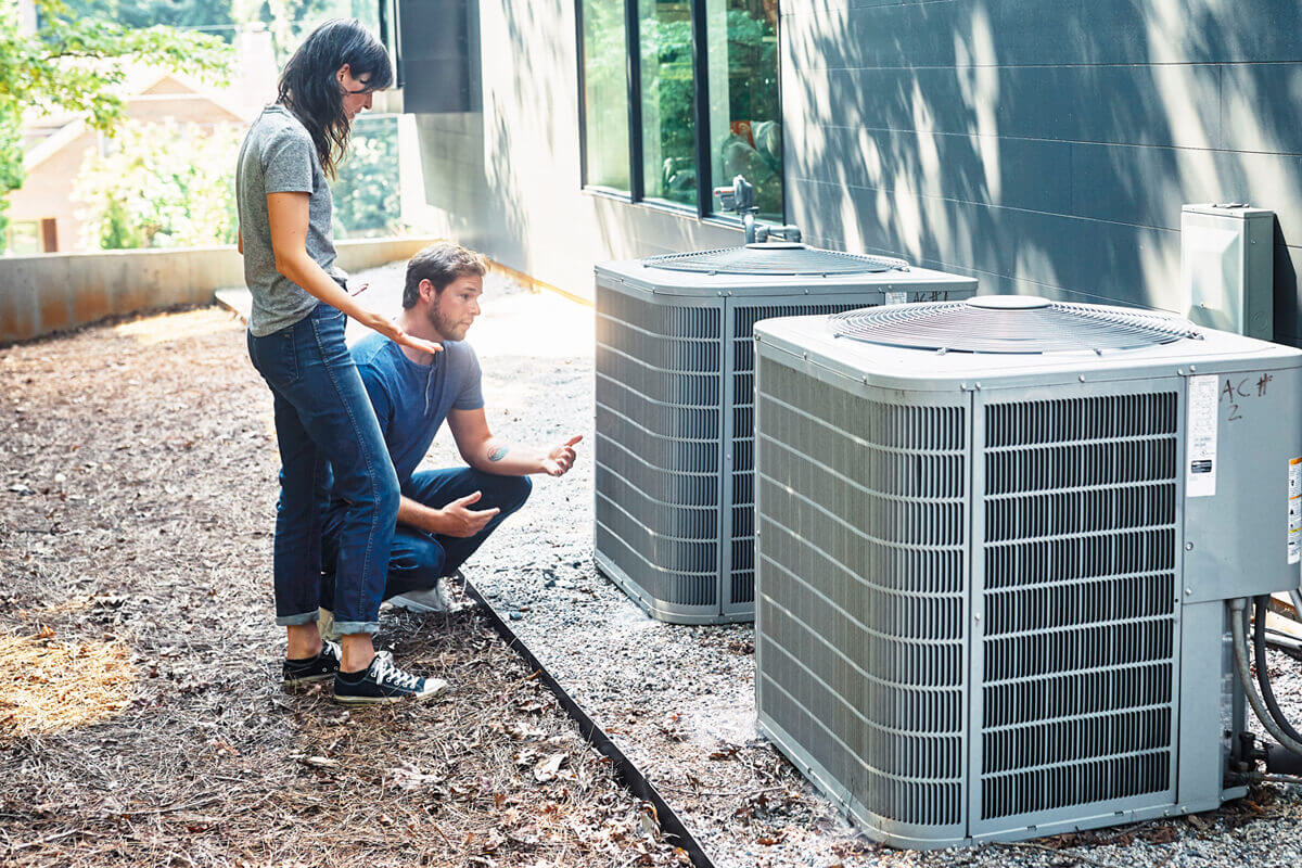 Couple looking at HVAC Unit