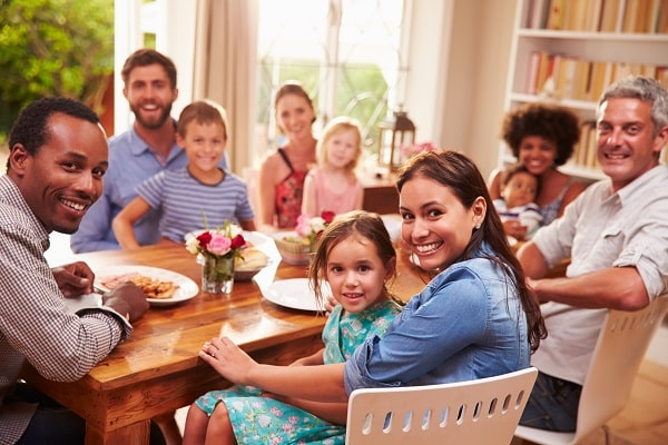 Family And Friends Sitting At Table