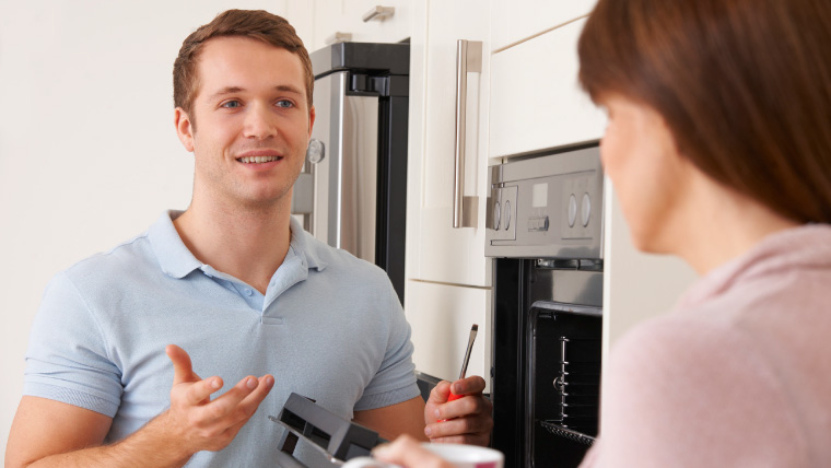 img electrician talking with woman in kitchen 53237632729